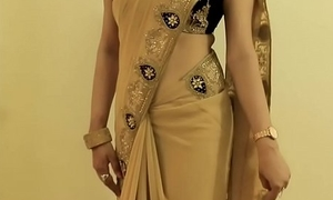HOT GIRL SAREE WEARING with an increment of Showing her NAVEL with an increment of Roughly